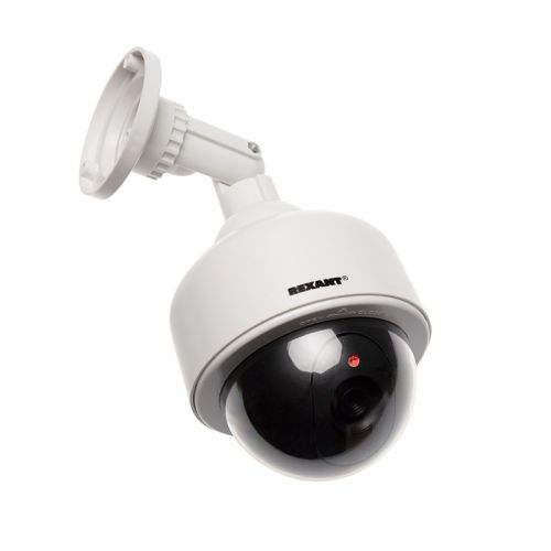 Муляж камеры видеонаблюдения Rexant 45-0200 Неотличим от обычной камеры. Мигающий красный светодиод (каждые 5 секунд) Питание: батарейки AА - 2шт. Мат